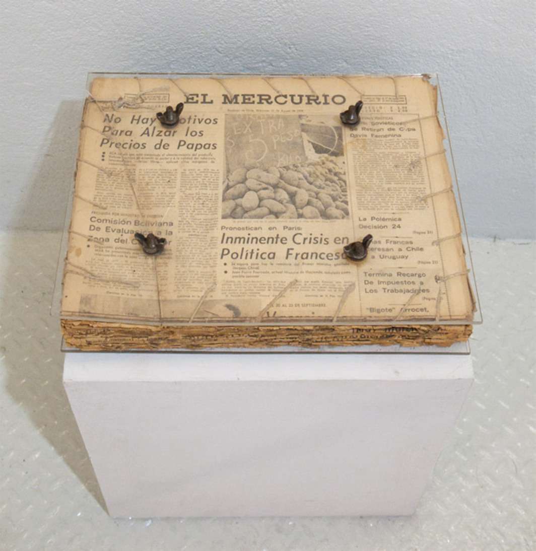 "Catalina Parra, Diario de Vida (Diary of Life), 1977, El Mercurio newspapers, thread, Plexiglas, metal bolts, metal nuts, 12 x 6 x 16""."