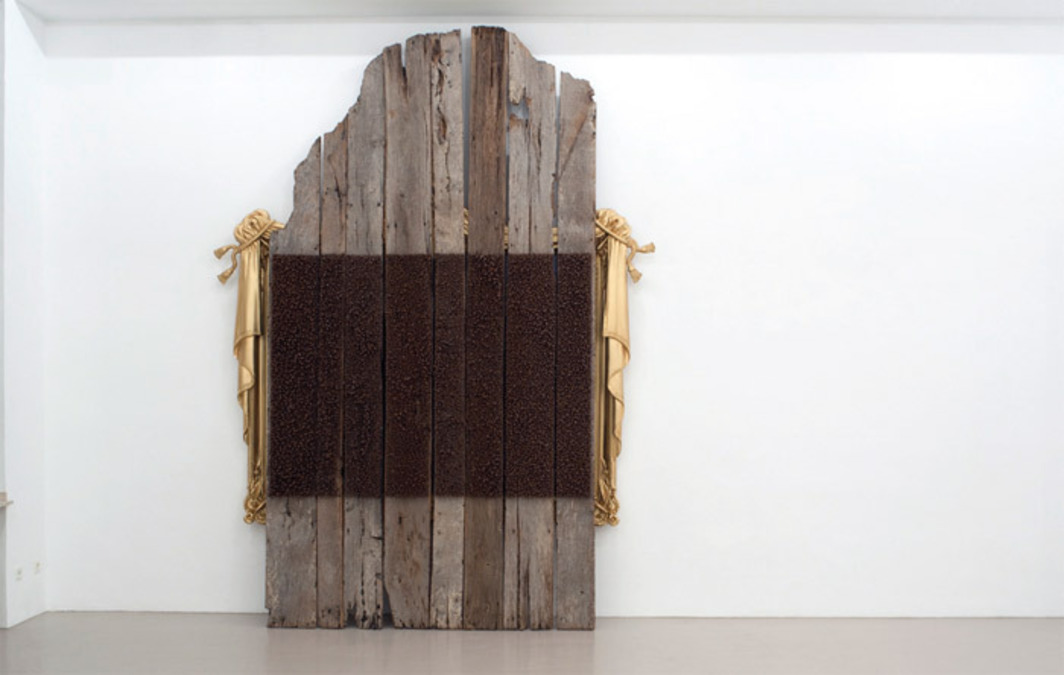 "Mel Chin, Safe, 2005, oil on Belgian linen, gilded wood and plaster, weathered wood, nails, 11' 1"" x 7' x 1' 6""."