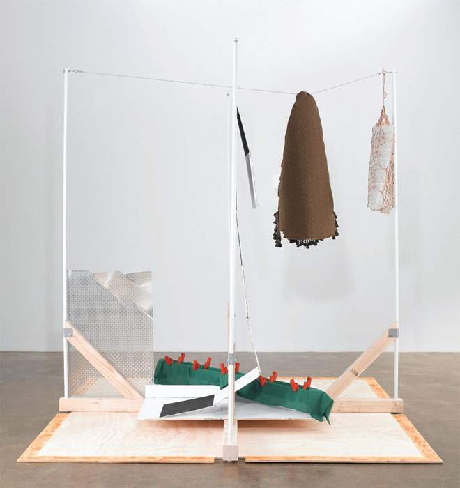 "Richard Tuttle, System 2, Winter, 2011, 2 x 4"" fir lumber, 4 x 4"" fir lumber, acrylic, asphaltum, balsa wood, beet juice, bolts, bubble wrap, cotton string, enamel, fabrics, feathers, fir plywood, galvanized metal, glass beads, leather, metal, pine, vinyl-coated steel cable, powder-coated iron, straight pins, Styrofoam, wing nuts, wire, 96 x 96 x 96""."