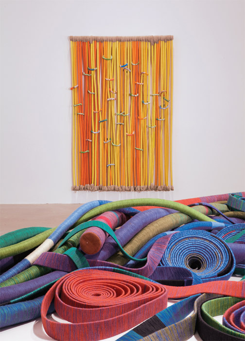 "View of ""Sheila Hicks,"" 2011. Foreground: May I Have This Dance? (detail), 2002–2003. Back-ground: La Mémoire, 1972/2010."