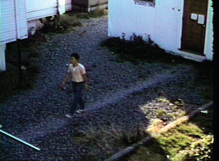 Ken Lum, Walk Piece, 1978, still from a color video, 3 minutes 5 seconds.