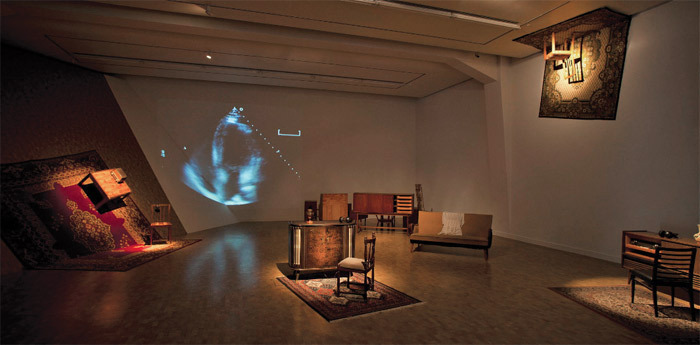 Helga Hansdóttir and Magnús Pálsson, Dialogues on Death, 2003–11, furniture, rugs, clothes, radios, CDs, headphones, sound, video record-ings. Installation view.
