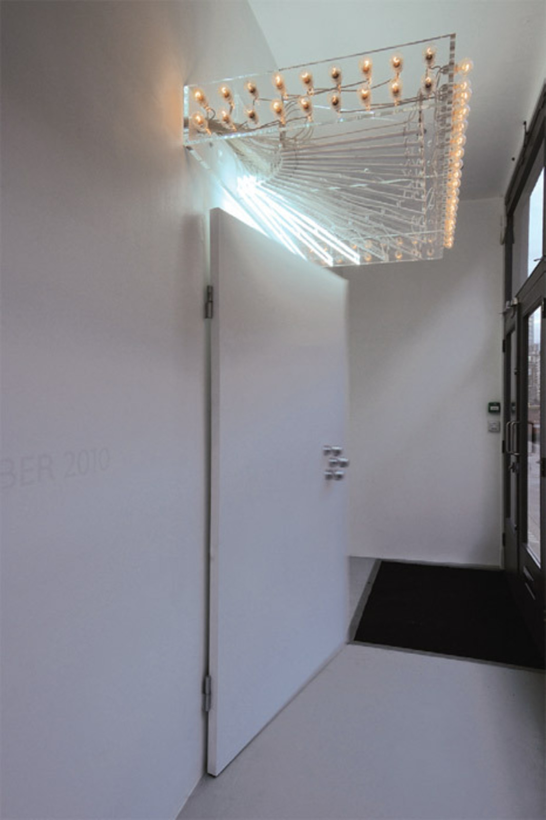 "View of ""Philippe Parreno,"" 2010–11. Door: Your Days, My Nights (Door, Automation No.1), 2010. Marquee: Your Days, My Nights (Marquee), 2010. Pilar Corrias."
