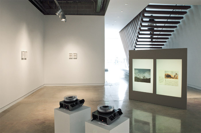 "View of ""Lisa Tan,"" 2010. Foreground: National Geographic, 2009. Background: Letters from Dr. Bamberger, 2001–."