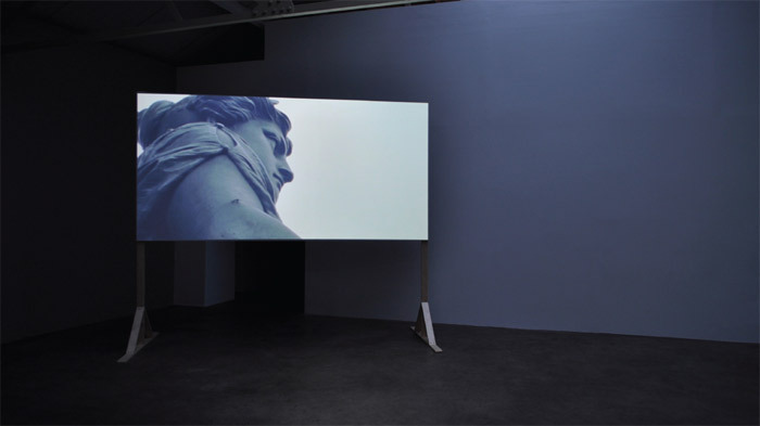Declan Clarke, We'll Be This Way Until the End of the World, 2008, color film in 16 mm transferred to video, 4 minutes 5 seconds. Installation view.