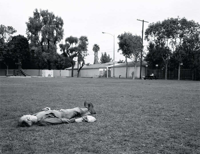 "Jeff Wall, Citizen, 1996, black-and-white photograph, 71 1/4 x 92 1/8""."