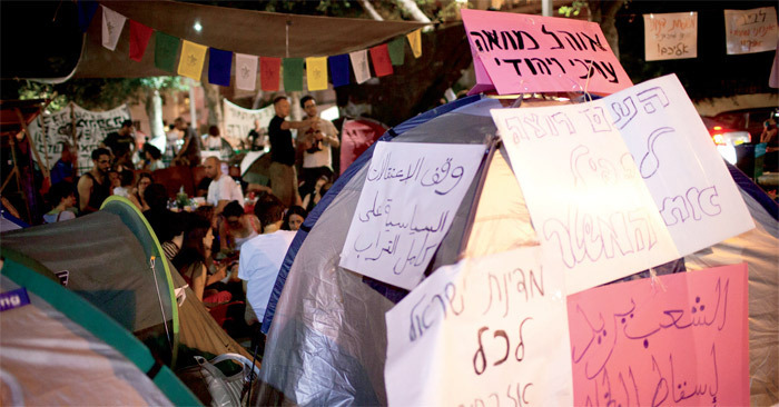 Signs attached to Tent 48 during a protest, Rothschild Boulevard, Tel Aviv, July 29, 2011. Photo: Oren Ziv/Activestills.