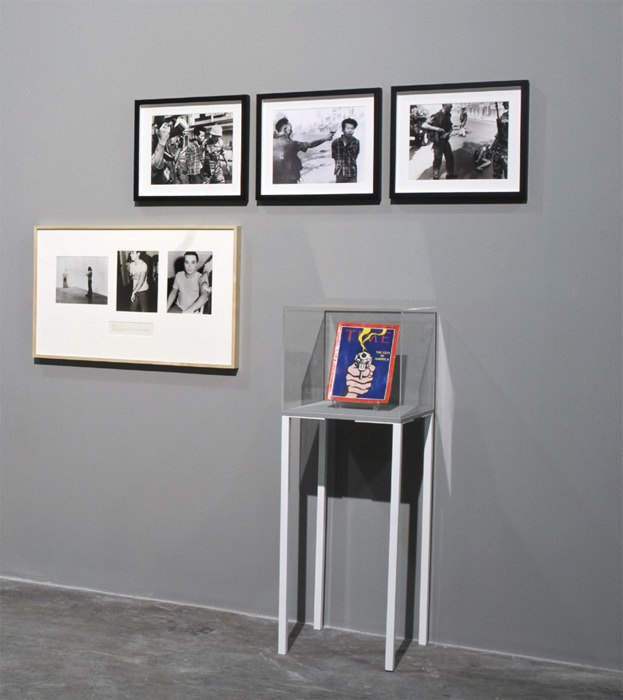 "View of ""'Untitled' (Death by Gun),"" 2011, Antrepo 3, Istanbul. Clockwise from left: Chris Burden, Shoot, 1971; Eddie Adams, Viet Cong Prisoner Being Escorted, Saigon, 1968; Eddie Adams, Street Execution of a Viet Cong Prisoner, Saigon, 1968; Eddie Adams, General Holstering Gun After Execution, Saigon, 1968; Roy Lichtenstein, The Gun in America (Time Magazine), 1968."