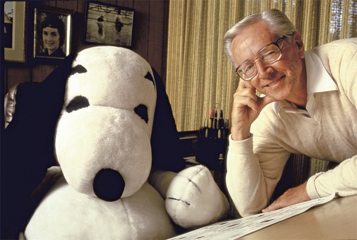 *Cartoonist Charles M. Schulz with Snoopy, 1987*. Photo: Matthew Naythons/Time & Life Pictures/Getty Images.