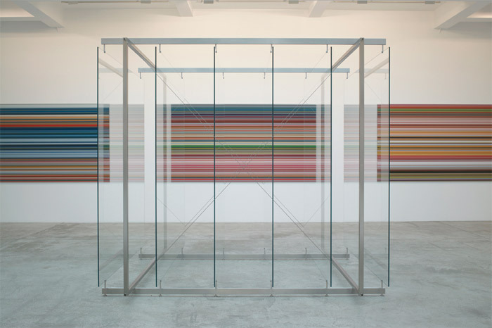 "View of ""Gerhard Richter,"" 2011. Wall, from left: STRIP, 2011; STRIP, 2011; STRIP, 2011. Foreground: 6 Standing Glass Panes, 2002/2011."