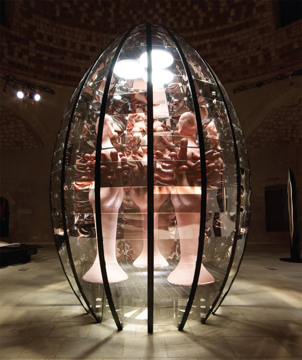 "Kalliopi Lemos, The Big Egg and the Hairy Goddesses, 2007–11, mild steel and two- way acrylic mirror; papier-mâché, animal hair, 13' 1 1/2"" x 8' 10 3/4"" x 8' 10 3/4"". Ibrahim Khan Mosque, Rethymno, Crete."