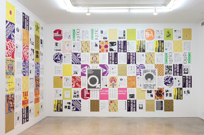 "View of ""Andrea Bowers,"" 2011. Collaged posters: The New Woman's Survival Guide, 2011. Framed, from left: Wanted By the Law, 2011; Angela Davis—You Are Welcome in This House (In Honor of Julian Madyun), 2011."