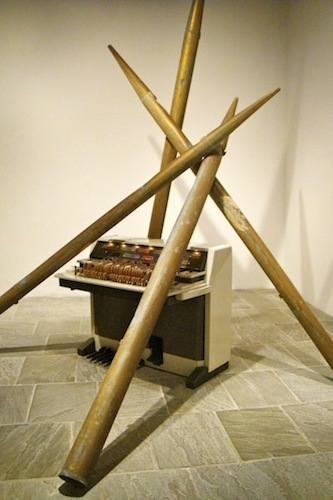 Lutz Bacher, Pipe Organ, 2009-2011, tin, paint, speakers, four pipes, and a Yamaha organ, dimensions variable.