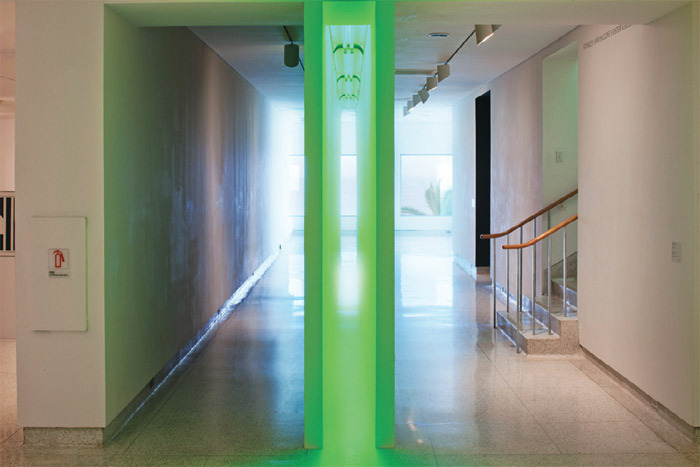 Bruce Nauman, Green Light Corridor, 1970, painted wallboard, fluorescent light fixtures with green lamps. Installation view, Museum of Contemporary Art San Diego, La Jolla, 2011. Photo: Pablo Mason.