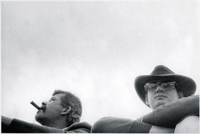 John Chamberlain and Larry Bell at the motorcycle races, Bridgehampton, NY, 1966. Photo: Barbara Brown.