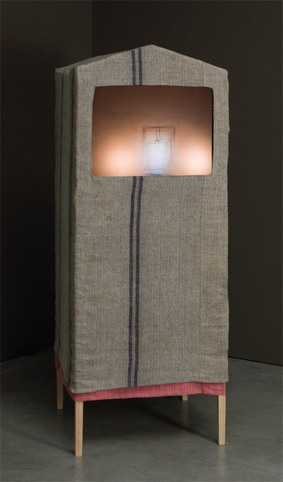 "João Penalva, Petit Verre (Small Glass), 2007, shadow theater, wood, fabric, and PVC (music commissioned from Zhuomin Chan), 63 x 24 1/4 x 24 3/4""."