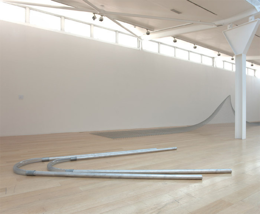 "View of ""Bill Bollinger,"" 2011–12. Foreground: Pipe Piece, 1968–69. Background: Cyclone Fence, 1968/2011."