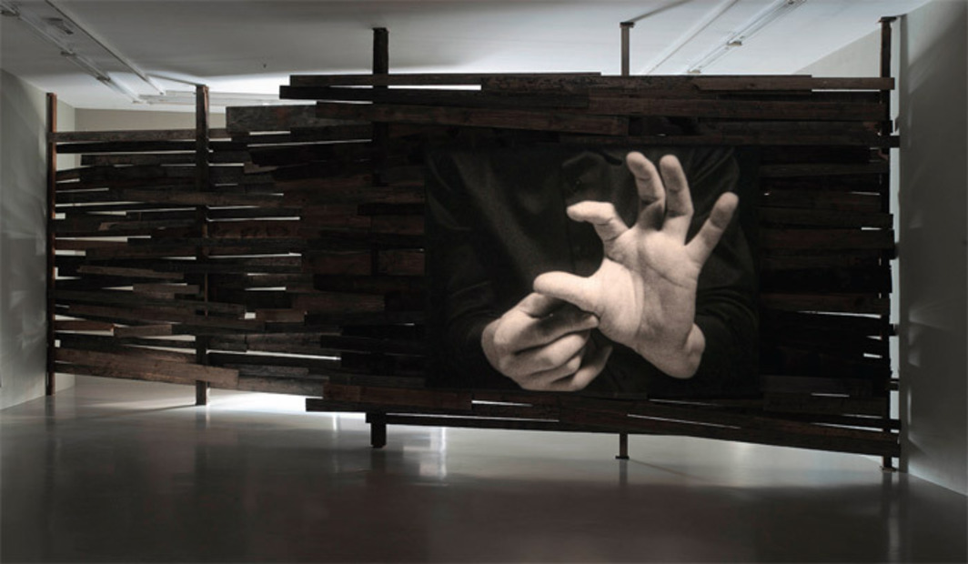 Joachim Koester, Variations of Incomplete Open Cubes, 2011, wood, black-and-white 16-mm film projection, 8 minutes 15 seconds. Installation view.