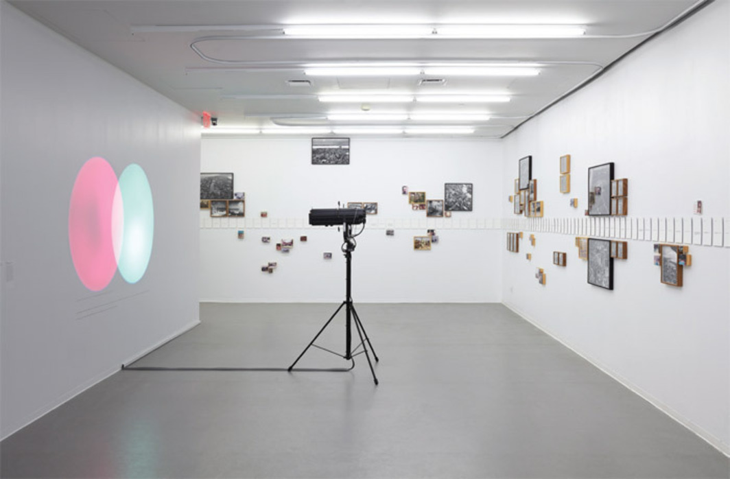 "View of ""The Ungovernables,"" 2012. From left: Amalia Pica, Venn Diagrams (under the spotlight), 2011; Jonathas de Andrade, Ressaca Tropical (Tropical Hangover), 2009. Photo: Benoit Pailley."