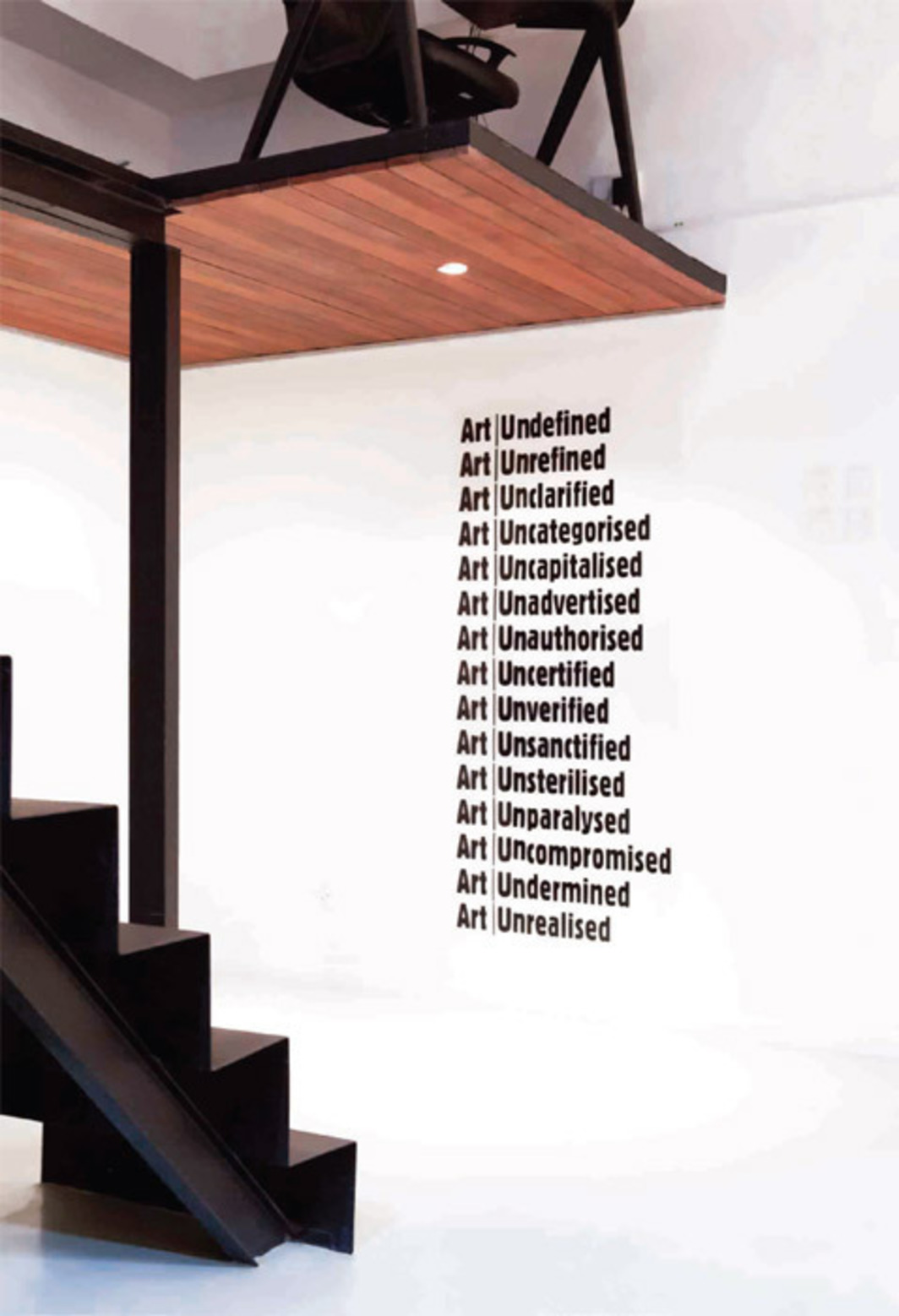 "Will Kwan, Untitled (Art | UN), 2011, self-adhesive vinyl, 57 7/8 x 26 3/8""."