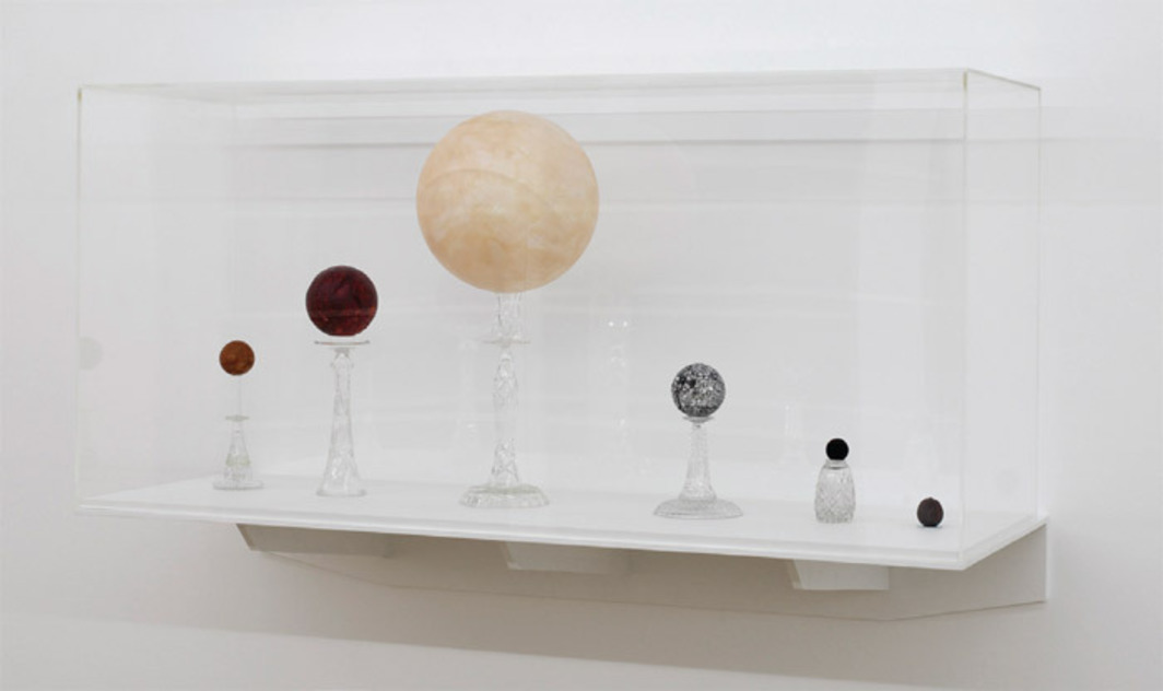 "Björn Dahlem, Sonnen (Suns), 2011, glass, wood, Styrofoam, steel, lemon, velvet ball, lacquer, shellac, 27 1/2 x 59 x 19 5/8""."