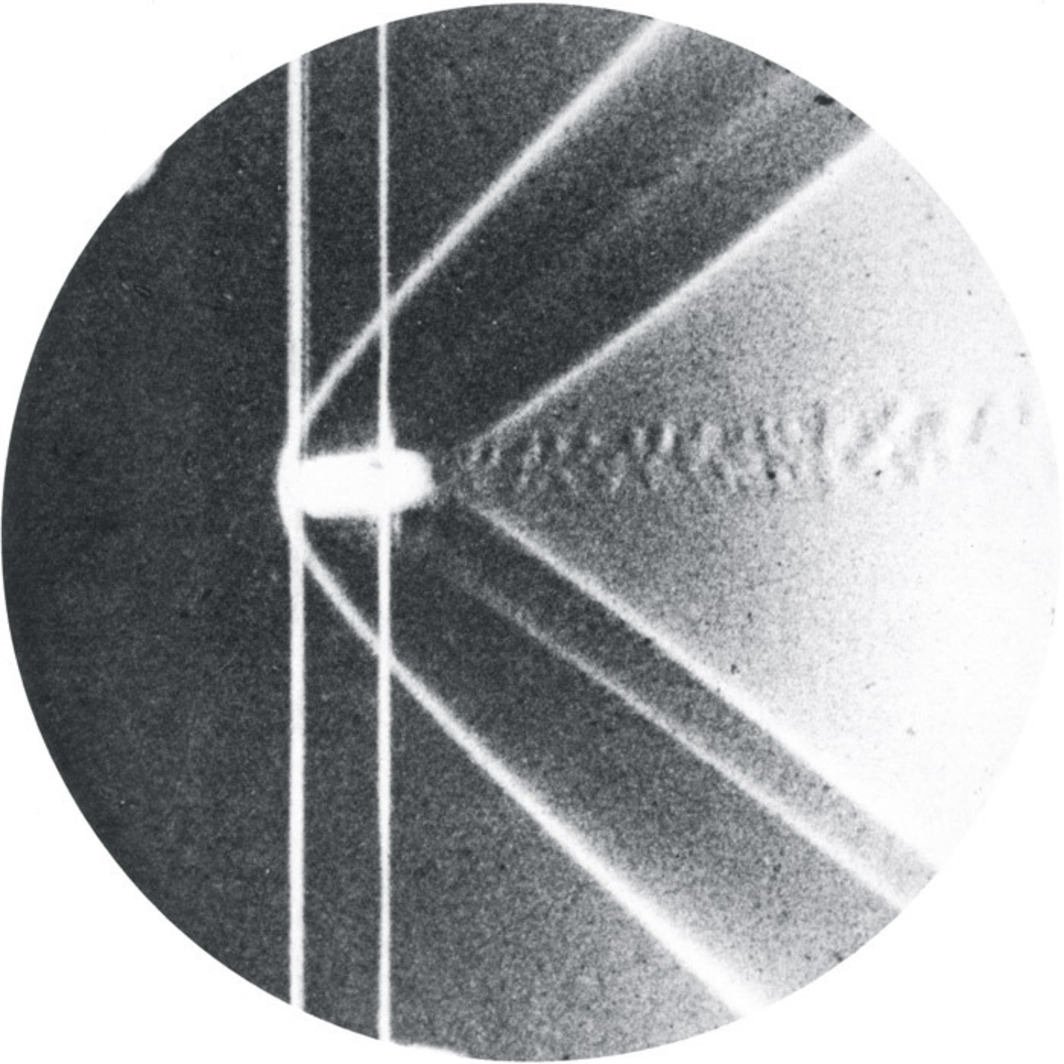 High-speed photograph of a bullet's shock wave, taken by Ernst Mach in 1877.
