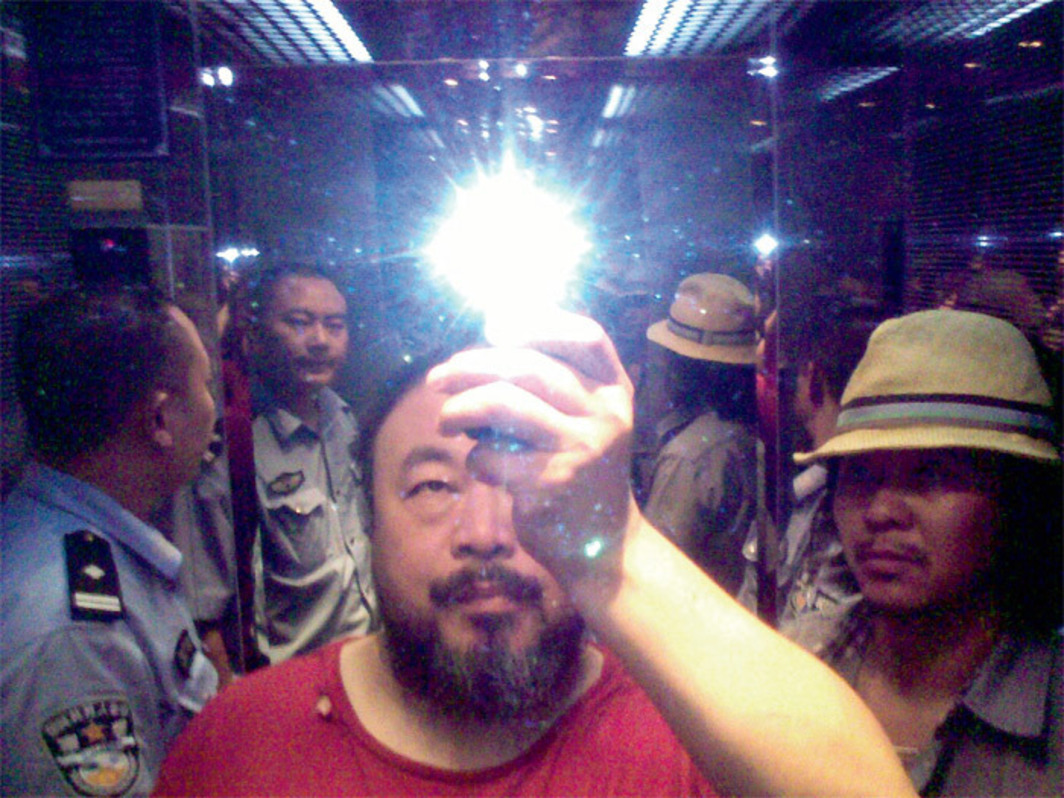 "Ai Weiwei, Ai Weiwei in the elevator when taken in custody by the police, Sichuan, China, August 2009, C-print, 4 3/8 x 5 7/8""."