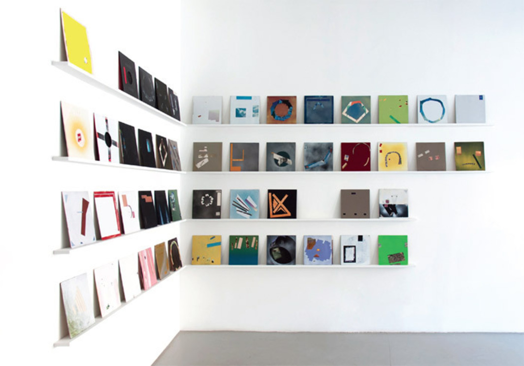 Jerome Acks, Album (#1–80), 2012–, found albums, spray enamel. Installation view.