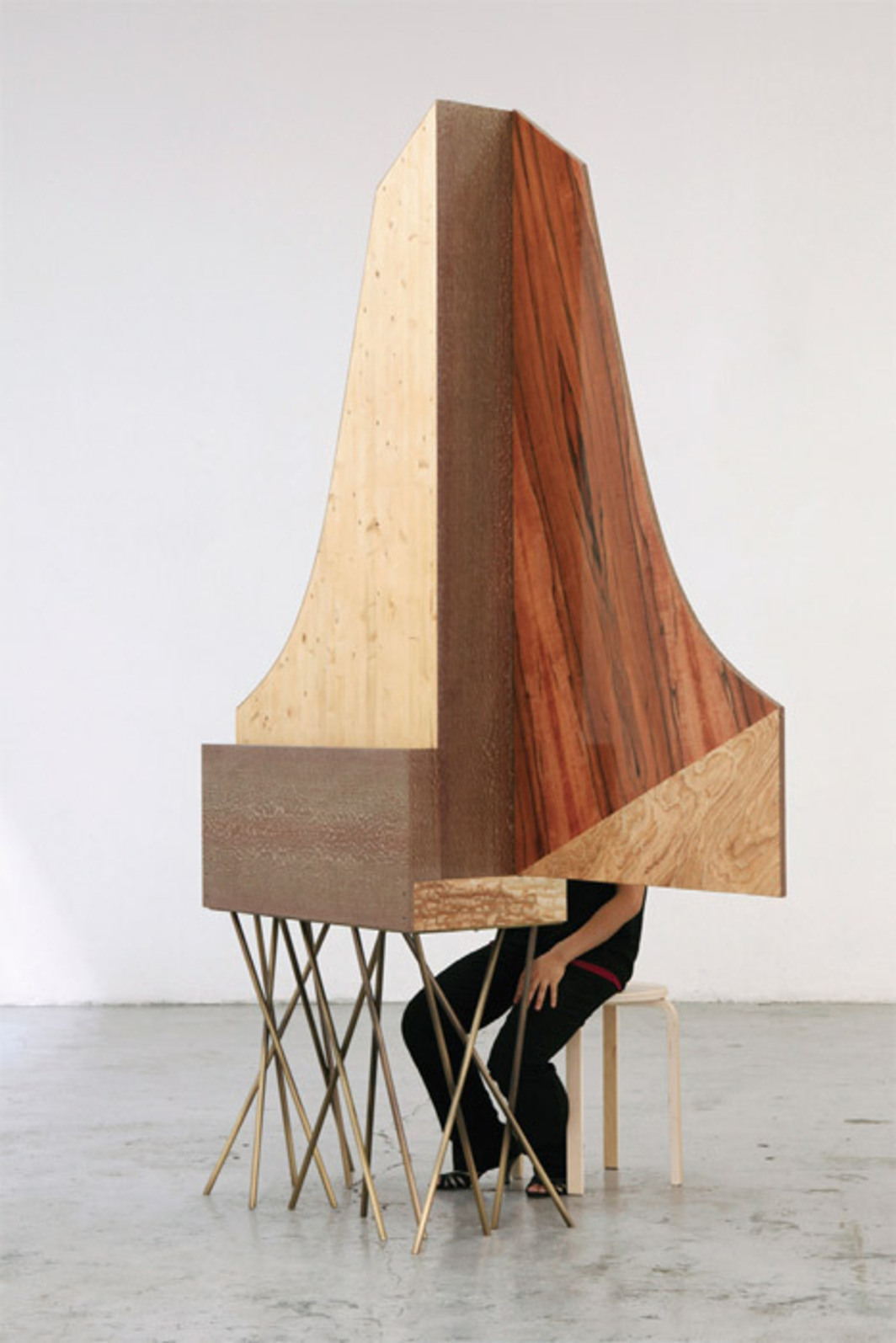 "Riccardo Beretta, Donnerwetter, 2011–12, natural dyed veneers, wood, brass, 93 1/4 x 63 x 16 1/8"". Performance view."