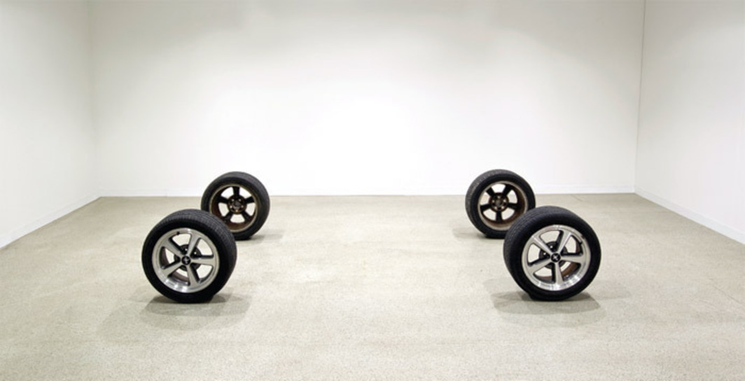"Nick Relph, Raining Room, 2012, car wheels, 2' 1"" x 5' 9 1/4"" x 10' 6 1/4""."