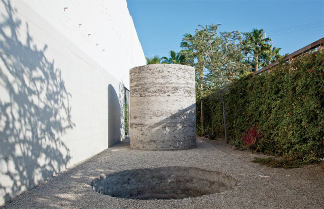"Nobuo Sekine, Phase—Mother Earth, 1968/2012, earth, cement. Installation view, Blum & Poe, Los Angeles, 2012. From ""Requiem for the Sun: The Art of Mono-ha."" Photo: Joshua White."