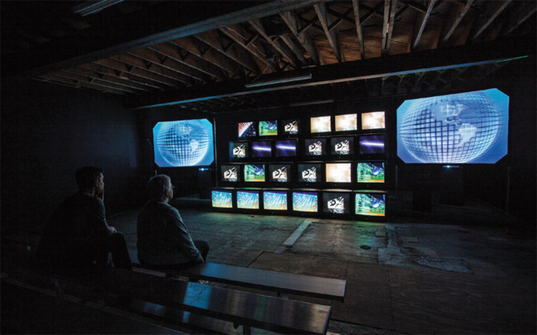 Gretchen Bender, Total Recall, 1987, eight-channel video on twenty-four monitors and two rear-projection screens, sound, 18 minutes 2 seconds. Installation view.