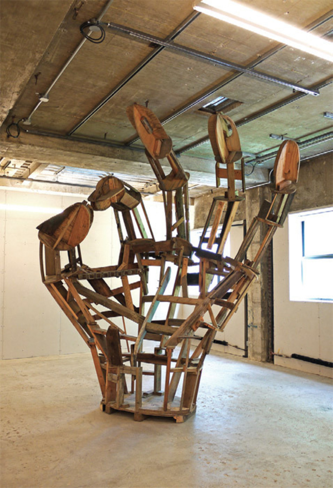 "Peter Coffin, Untitled (Unfinished OK Hand), 2012, wood, wire mesh, bolts, screws, 12' 7 1/2"" x 6' 5"" x 11' 6""."