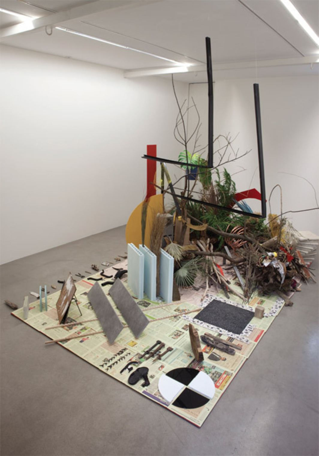 "Camille Henrot, ""Robinson Crusoé,"" Daniel Defoë, 2012, mixed media. Installation view. From the series ""Est-il possible d'être révolutionnaire et d'aimer les fleurs?"" (Is It Possible to Be a Revolutionary and Like Flowers?), 2011–12."