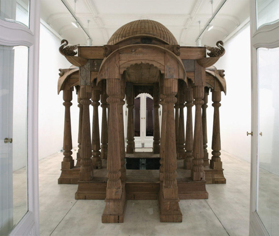 "Sudarshan Shetty, Untitled (from the show ""the pieces earth took away""), 2012, hand-carved teak, acrylic, water pump, 12' x 11' 6 1/2"" x 11' 6 1/2""."