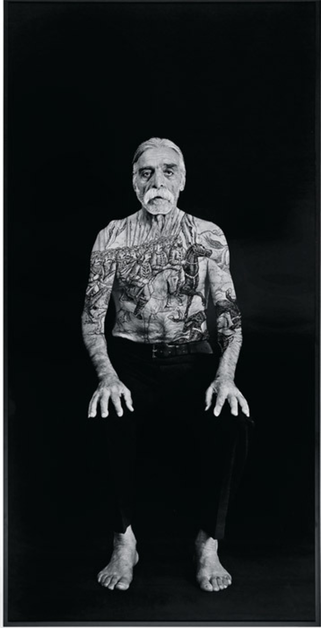"Shirin Neshat, Bahram, 2012, ink on gelatin silver print, 99 1/8 x 49 1/2"". From the series ""The Book of Kings,"" 2012."