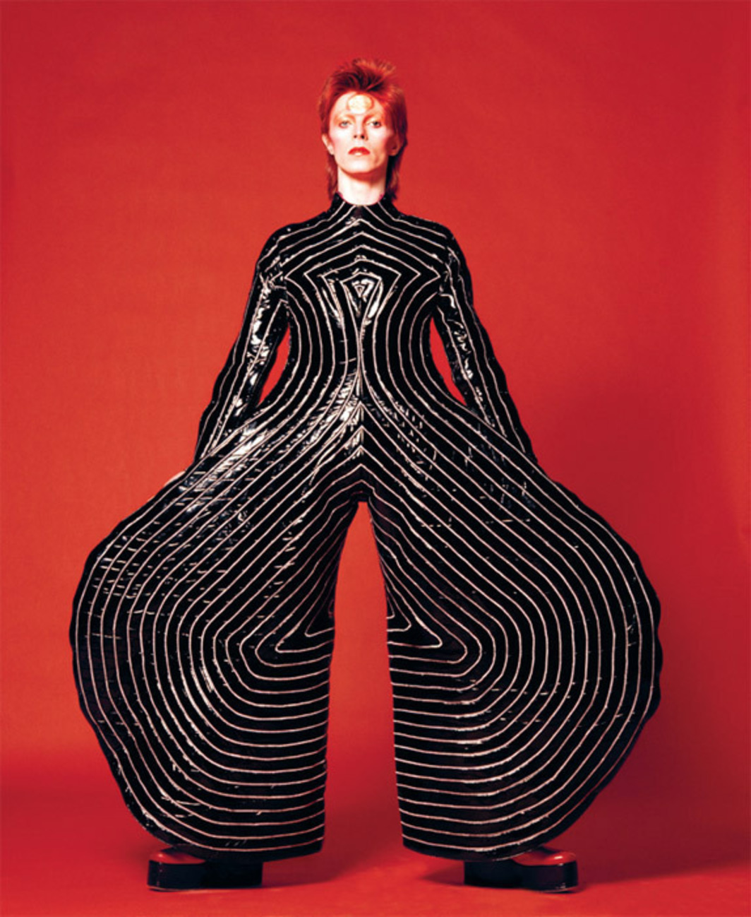 David Bowie wearing striped bodysuit designed by Kansai Yamamoto for the Aladdin Sane tour, 1973. Photo: Masayoshi Sukita.
