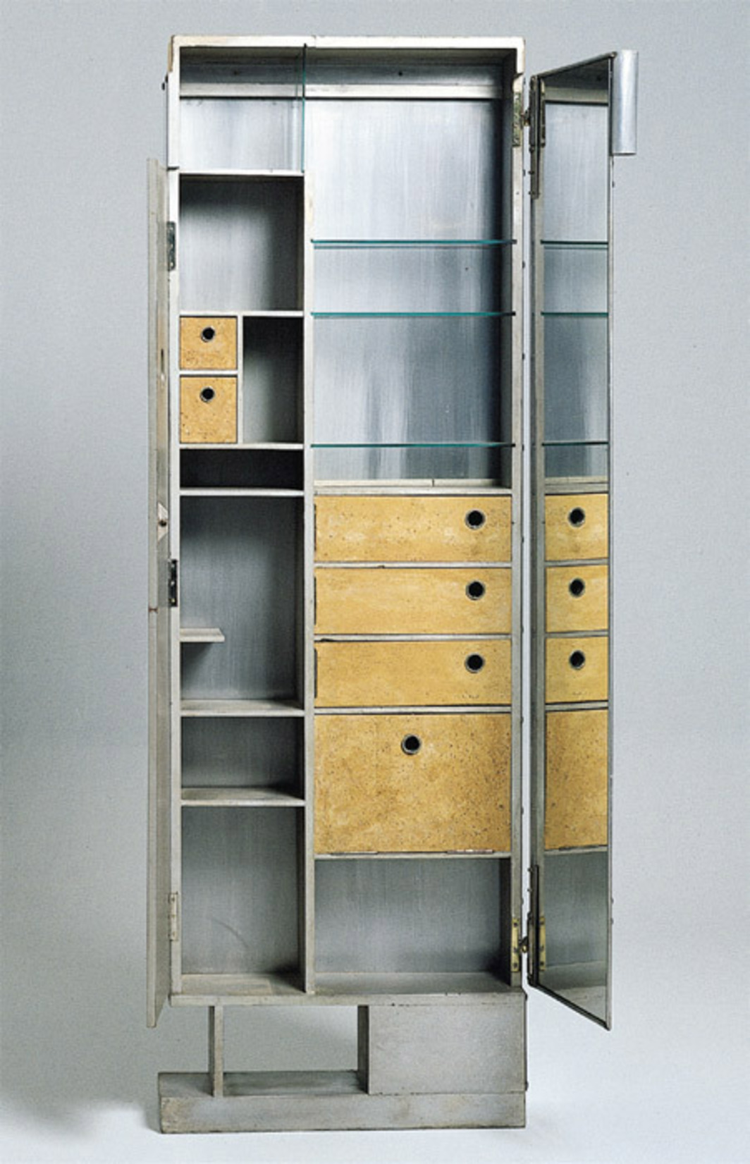 "Eileen Gray, toiletry cabinet-screen, 1927–29, wood, aluminum, mirrors, glass, cork, 64 5/8 x 22 x 7""."