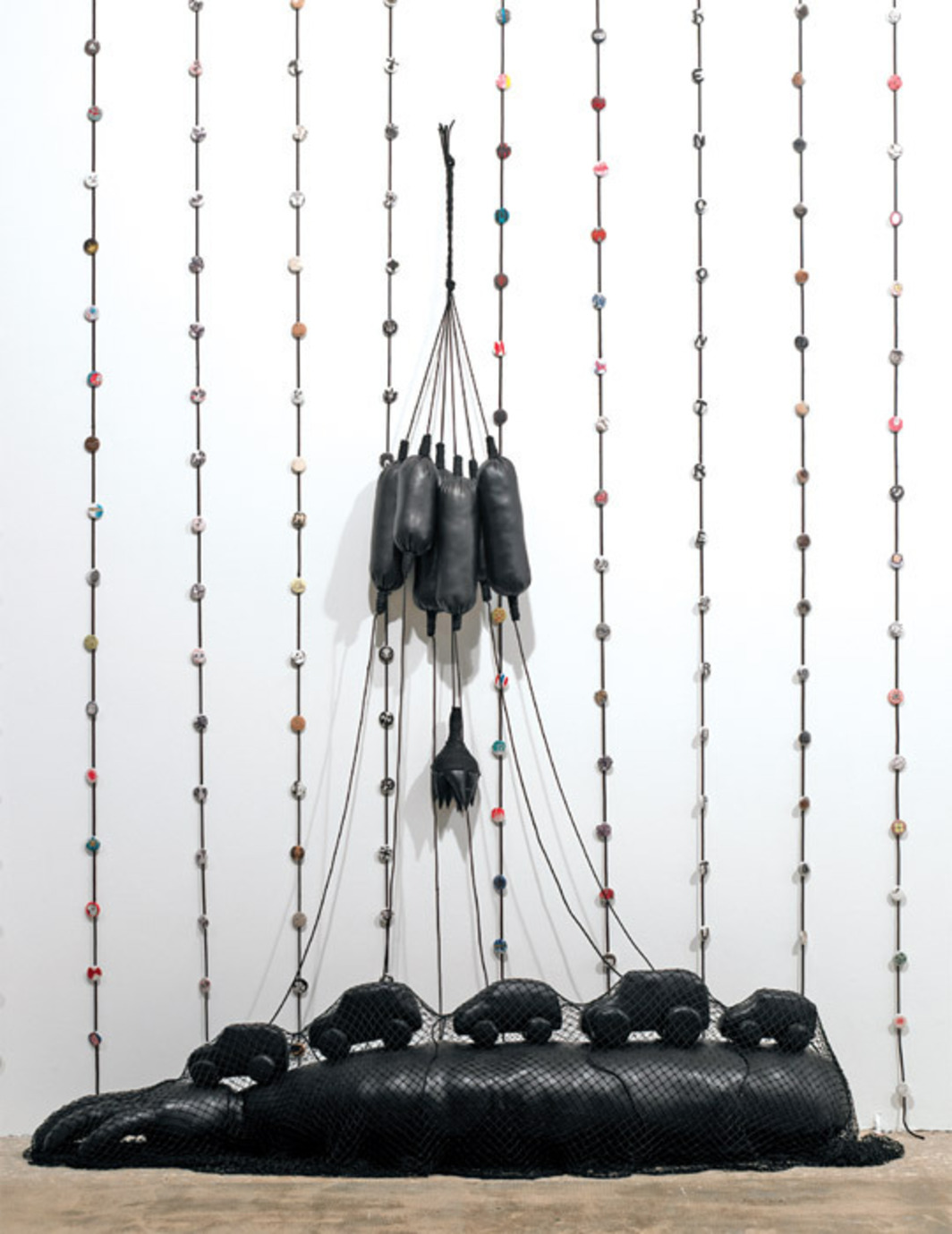 "Annette Messager, Bras/Voitures (Arm, Cars), 2009, mixed media, 97 5/8 x 78 3/4 x 19 5/8""."