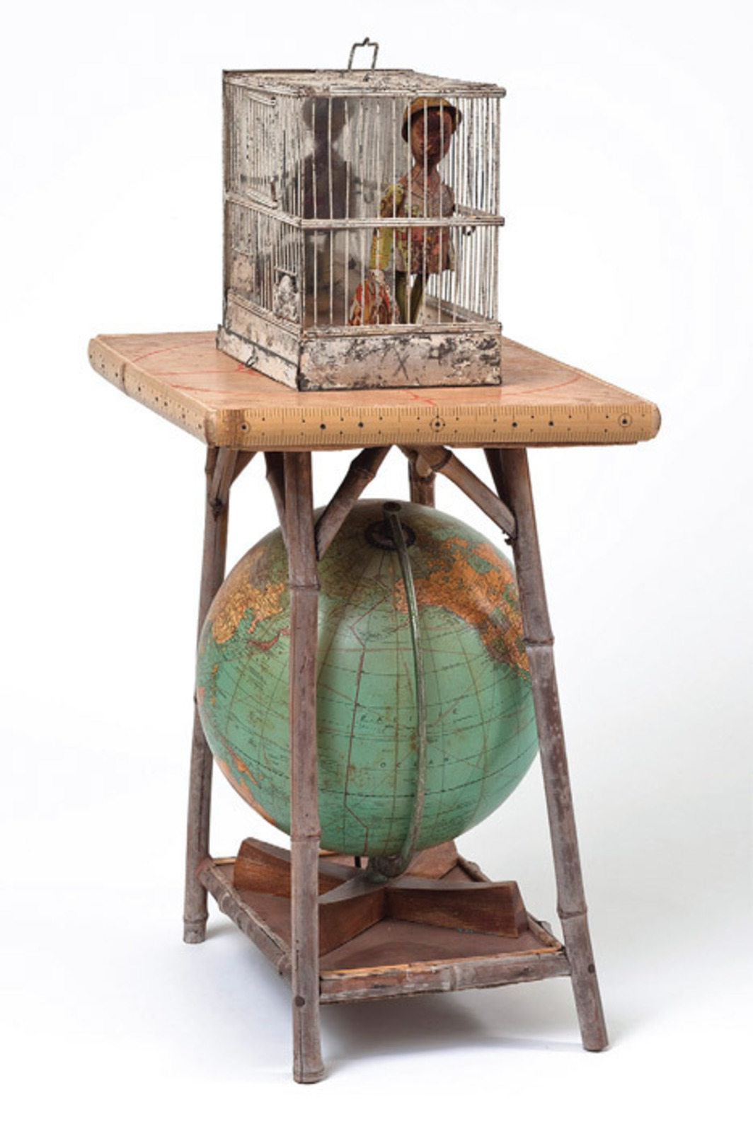 "Betye Saar, Globe Trotter, 2007, mixed media, 32 1/2 x 18 1/4 x 14 1/8""."