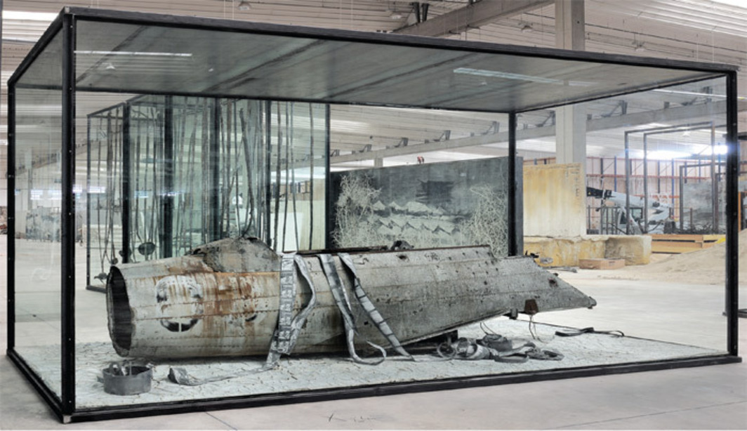 "Anselm Kiefer, Merkaba, 2010, airplane fuselage, photographs, lead, inscribed glass, steel vitrine; oil, emulsion, acrylic, shellac, and clay on canvas, 10' 6 1/2"" x 18' 4 1/2"" x 7' 6 5/8""."