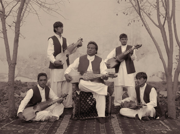 "Simon Norfolk, At a Music School in Kabul, Boys Are Taught the Traditional Afghan Instrument, the Rubab, 2010, black-and-white photograph, 20 x 24"". From the series ""Burke + Norfolk,"" 2010–11."