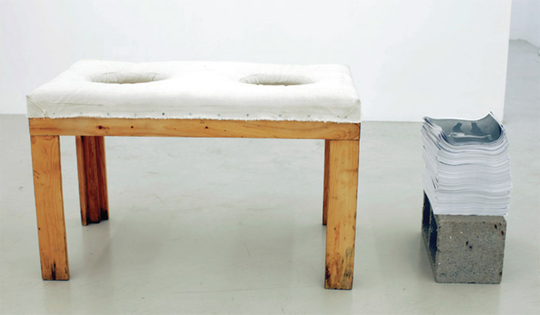 "Lee Maida, Bench For Two Heads, 2010, wood, hardware, canvas, photocopies, concrete, 36 x 20 x 24"". From ""ACP."""