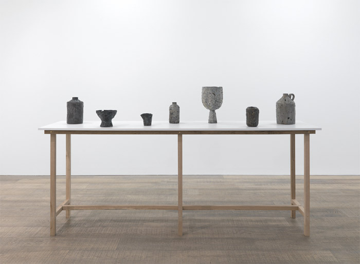 "Ricky Swallow, Make-Do Suite, 2010, patinated bronze, wooden table, 52 3/8 x 96 1/2 x 24 1/8""."