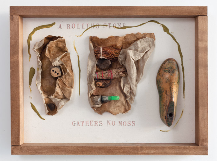 "Alison Knowles, A Rolling Stone Gathers No Moss, 2011, found materials, acrylic, raw flax, hand stamps, raw cotton, maple, tea-stained frame, 17 1/4 x 22 1/2 x 4""."