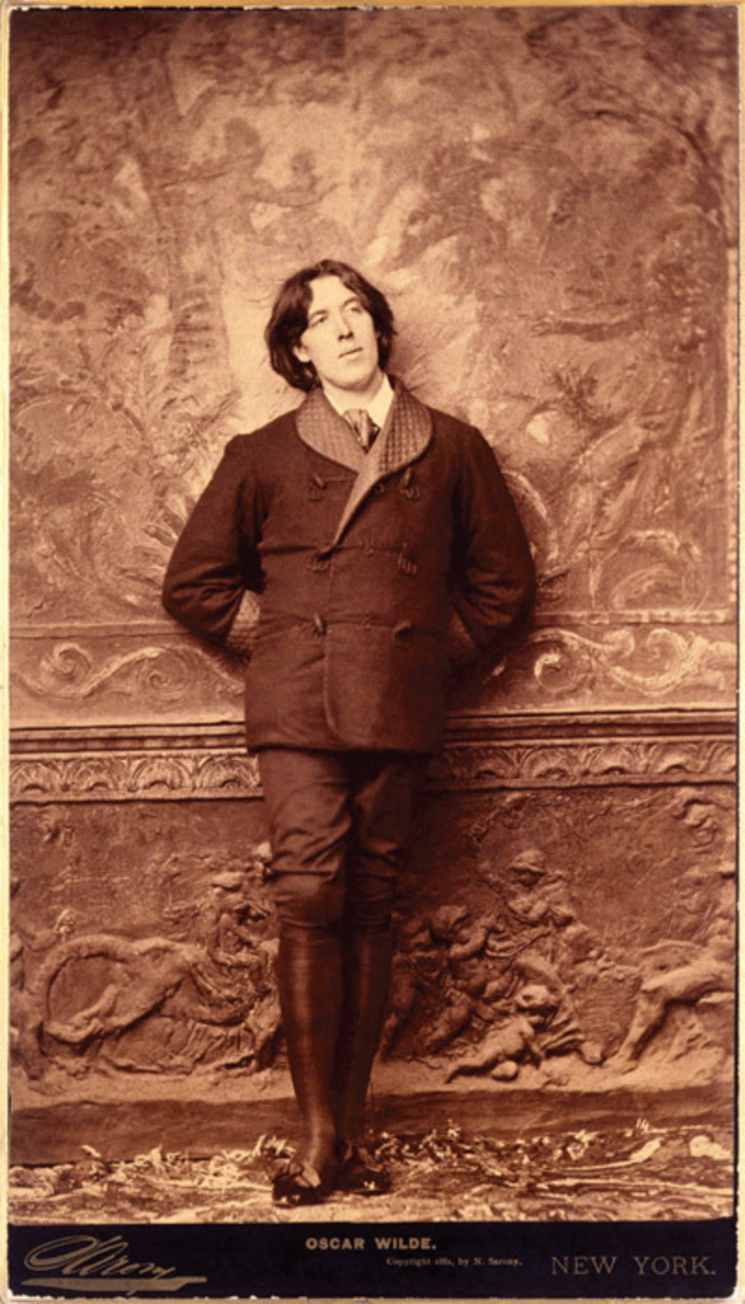 "Napoleon Sarony, Oscar Wilde, 1882, albumen panel print, 12 x 7 1/4"". From ""The Cult of Beauty."""