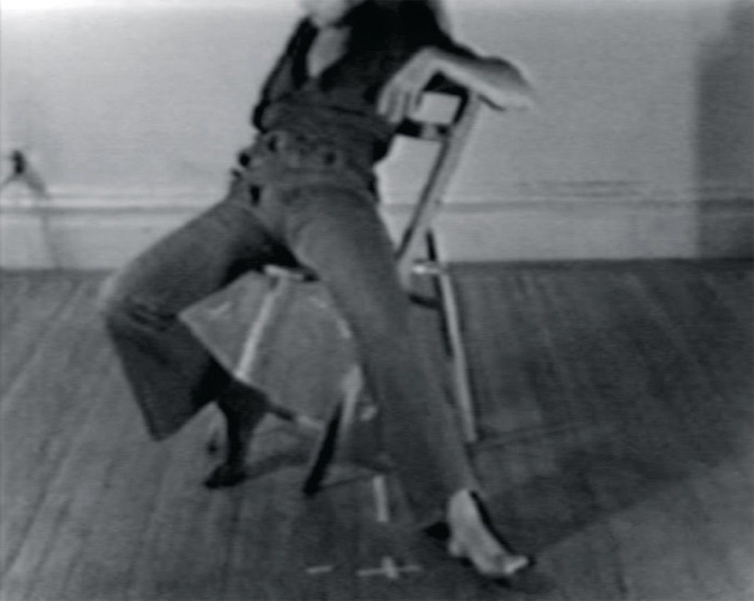 Dara Birnbaum, Chaired Anxieties: Abandoned, 1975, still from a black-and-white video, 5 minutes 15 seconds.