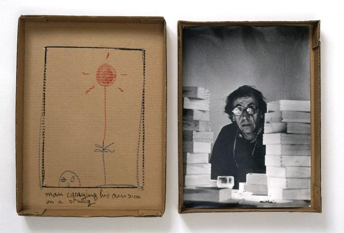 "Robert Filliou, Man Carrying His Own Sun on a String, 1973, cardboard box, black-and-white photograph, pastel, 17 5/8 x 25 x 2 3/8""."