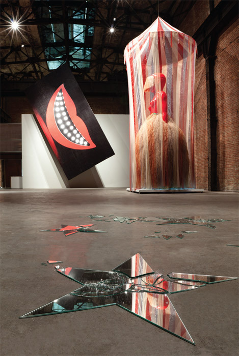 "View of ""Sanford Biggers: Cosmic Voodoo Circus,"" 2011. Foreground: Constellation 6.0, 2011. Background, from left: Cheshire (On Tilt), 2010–11; A Jóia Do Orixá (To the Jewel of the Orixa), 2011."