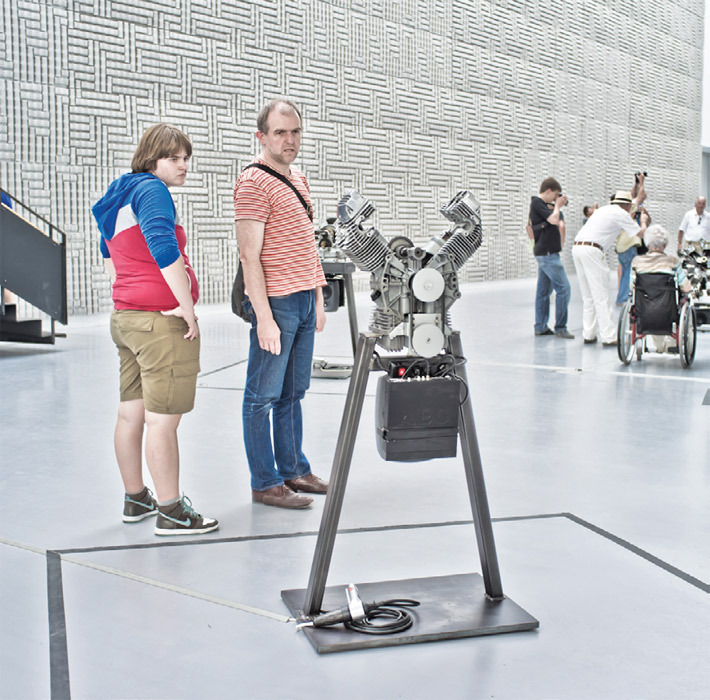 Viewers with Thomas Bayrle's Prega per noi (Pray for Us), 2012, Documenta Halle, Kassel, August 17, 2012. From Documenta 13. Photo: Hans Kettwig.